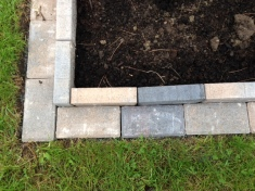 bricked edge of square planter