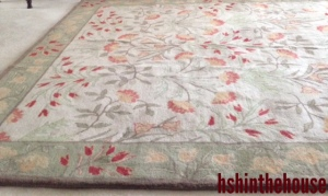 floral green and coral coloured rug