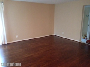 living room with hardwood floors, no furniture