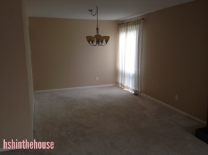 empty room with chandelier and white carpet