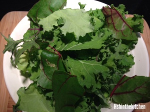 salad made with swiss chard and kale on white plate