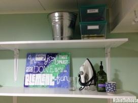 white shelves on green wall